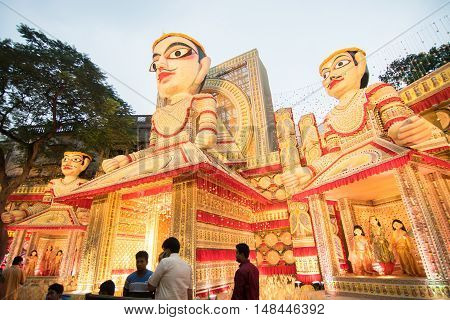 KOLKATA INDIA - OCTOBER 21 2015 : Beautiful exterior of decorated Durga Puja pandal at Kolkata West Bengal India. Durga Puja is biggest religious festival of Hinduism.