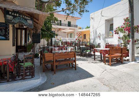 PALEOCHORA, CRETE, GREECE - JUNE 2016: Traditional Greek tavern at Paleochora town in western part of Crete island