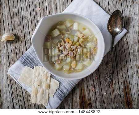 Rhode Island Clam Chowder Soup on Wood Background, top view.