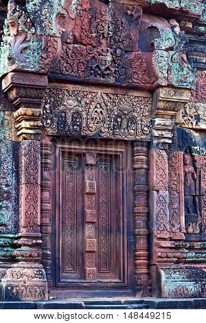 Ancient bas-relief at the facade of Banteay Srey Temple in Angkor Area, Cambodia. Banteay Srey is a 10th century Cambodian temple dedicated to the God Shiva.