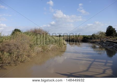 Wide flood of Nahal Alexander stream after winter rains, Israel