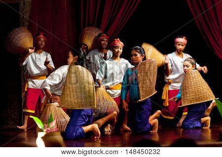 SIEM REAP, CAMBODIA - JANUARY 11, 2013: Khmer classical dancers performing traditional harvest dance in traditional costume.