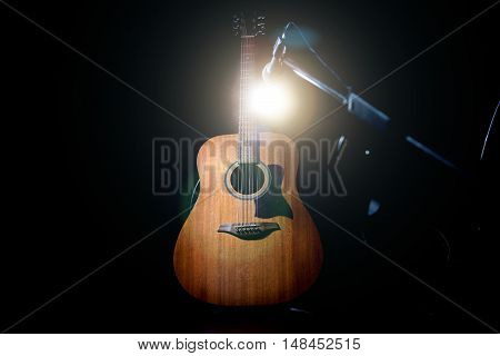 Acoustic Guitar Over Black Background
