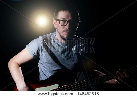 Man Playing On Electrical Bass Guitar