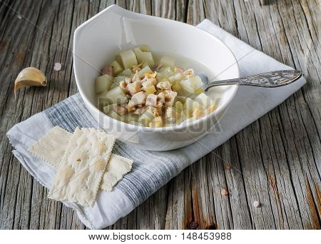 Rhode Island Clam Chowder Soup on Wood Background, selective focus.
