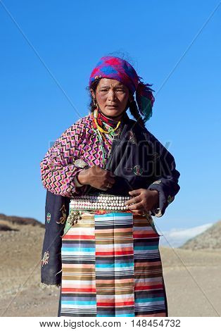 NGARI PREFECTURE, TIBET - MAY 7, 2013: Tibetan woman on the trail around sacred mount Kailash in Ngari Prefecture, Tibet Autonomus Region of China.