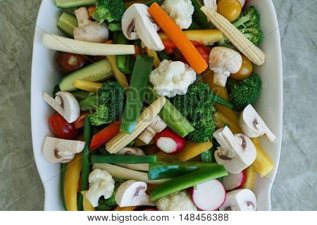 Vegetable Crudites and Dip/ vegetable platter on stone, marble background, healthy eating, top view, close-up.