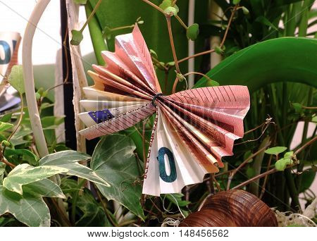 Original folded banknote in origami style to give away