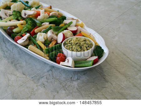 Vegetable Crudites and Dip/ vegetable platter on stone, marble background, healthy eating, selective focus.
