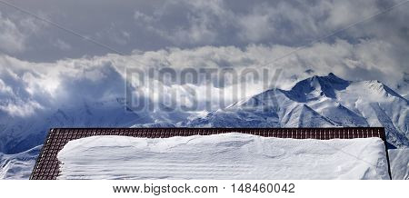 Panoramic View On Snowy Roof And Mountains In Clouds