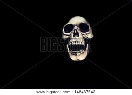 Creepy skull monster on a black background