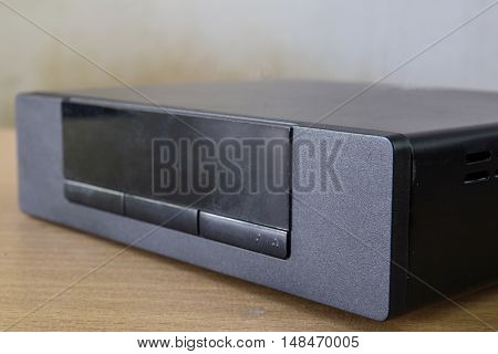 The hd player on wood a table