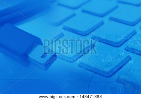 Thunderbolt Cable and keyboard abstract digital background
