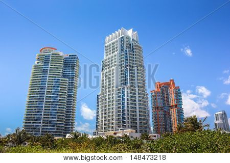 Miami skyscrapers. Miami South Beach in Downtown District in sunny day. Apartment and business buildings in Miami Beach, Florida.
