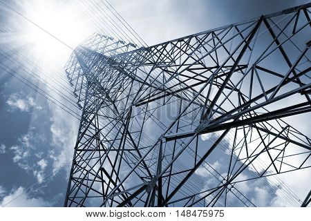 Electric Transmission Tower.electricity transmission pylon silhouetted against blue sky at dusk