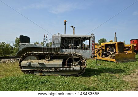 ROLLAG, MINNESOTA, Sept 1. 2016: Vintage Caterpillars are displayed at the West Central Steam Threshers Reunion in Rollag, MN attended by 1000's held annually on Labor Day weekend.