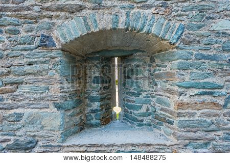 the slits used to the bows and balustrades/FENIS,ITALIA-SEPTEMBER . Detail of a slit of the Fenis castle in Aosta Valley on September 5 2016,in Fenis