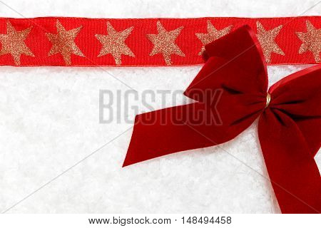 Red Bow And Ribbon With Stars In The Snow, Festive Background