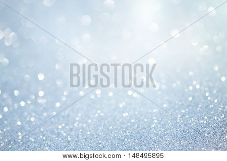 pastel blue glittering christmas lights. Blurred abstract holiday background