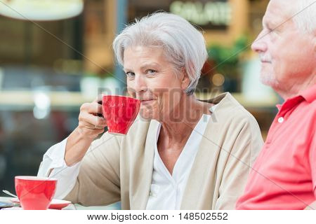 Seniors drink a coffee