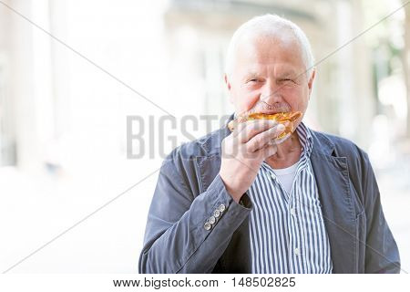 Senior man eats a