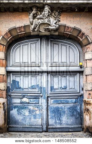 Antique old door detail in Toulouse France Europe