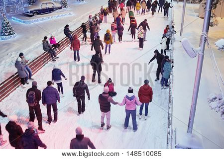 MOSCOW, RUSSIA - JAN 24, 2015: People have rest on scating rink in evening time at VDNKh. Ice skating rink at VDNKh is the largest in Europe - an area more than 20000 square meters.