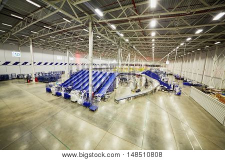 RUSSIA, MOSCOW - DEC 16, 2014: Workers in the automated sorting center at post department Vnukovo. Moscow Automated sorting center - the largest in Eastern Europe.