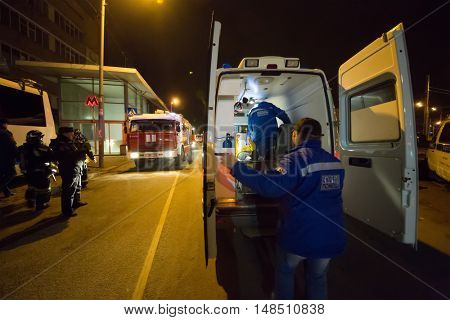 RUSSIA, MOSCOW - FEB 26, 2015: Ambulance and fire-engine with firefighters, paramedics are standing at Preobrazhenskaya ploshchad subway.