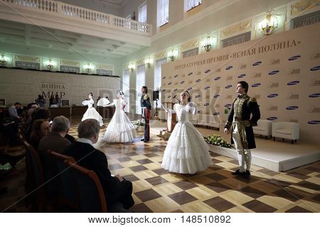 RUSSIA, MOSCOW - 05 MAR, 2015: Group of dancers are performing at literary award Yasnaya polyana in the Pashkov house.