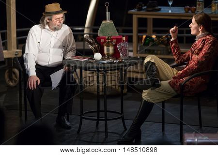 RUSSIA, MOSCOW - APR 15, 2015: Two actors are sitting on a chairs and playing his characters for performance (Kosmos) at drama theatre Modern.