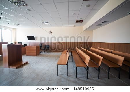 MOSCOW, RUSSIA - JUL 1, 2015: Hall of court of law with wooden furniture and screen on the wall