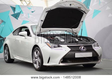 MOSCOW - FEB 14, 2015: Stylish white car with an open hood in a car showroom on Russian sixth test drive Lexus Master Class