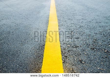 Yellow Line Slurry on the road in rainy season and Fog after rain