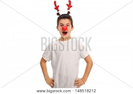Excitedl boy posing with red antlers and a red nose isolated on white background