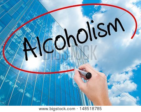 Man Hand Writing Alcoholism With Black Marker On Visual Screen.