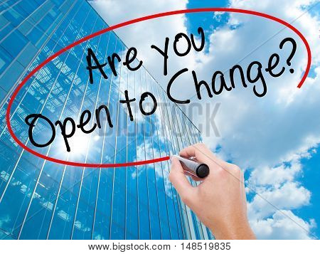 Man Hand Writing Are You Open To Change? With Black Marker On Visual Screen