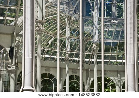 Detail of the windows of Crystal Palace (Palacio de Cristal in Spanish) Retiro Park Madrid. Spain. It is a glass pavilion inspired by The Crystal Palace in London. It is considered one of the best examples of architecture in iron and glass in Spain.