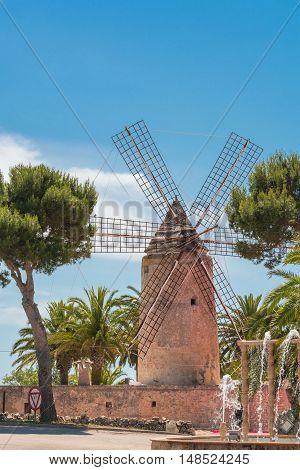 Old historic windmill on a farm of Majorca (Spain)