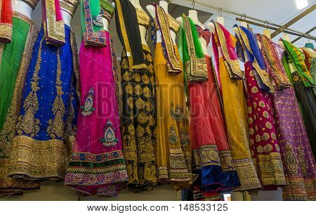 Racks of colourful Indian sari's for sale in a Indian market