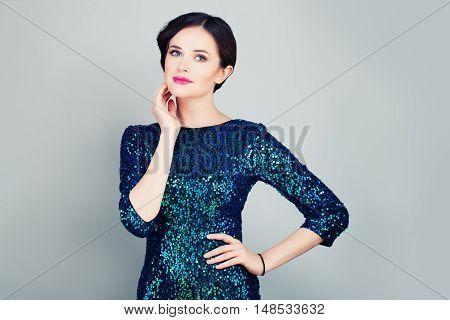 Glamorous Woman in Glitter Fashionable Dress Posing
