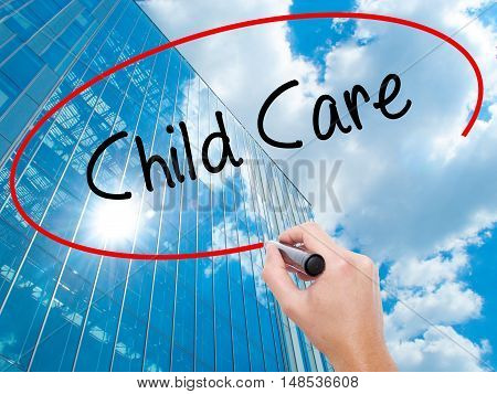 Man Hand Writing Child Care With Black Marker On Visual Screen