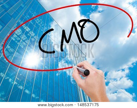 Man Hand Writing Cmo (chief Marketing Officer)   With Black Marker On Visual Screen
