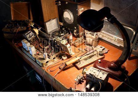 Workplace repairman old radio