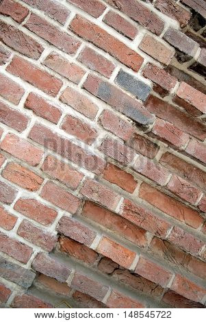 Corner of red brick wall with different prominence diagonal