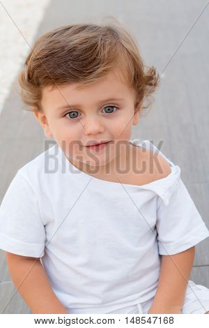 Funny baby one year with white t-shirt outdoor