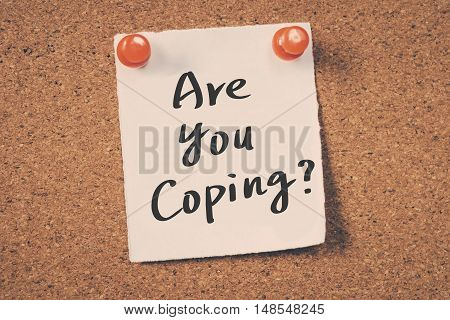 Are you coping? note pin on the bulletin board