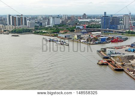 LONDON, ENGLAND - JULY 7, 2016: Aerial view of river Thames Leamouth Peninsula and Poplar from the Emirates Air Line cable cars.