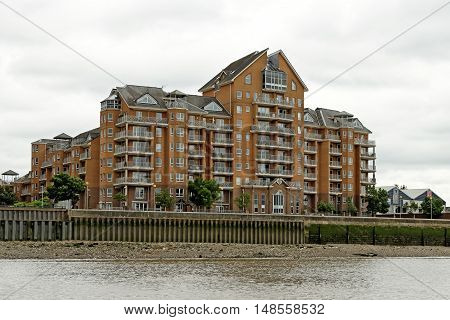 LONDON, ENGLAND - JULY 8, 2016: Hera Court a riverside residential estate on the Isle of Dogs in Docklands.