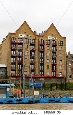 LONDON, ENGLAND - JULY 8, 2016: St John's Wharf - a riverside warehouse converted into apartments in Wapping area.
